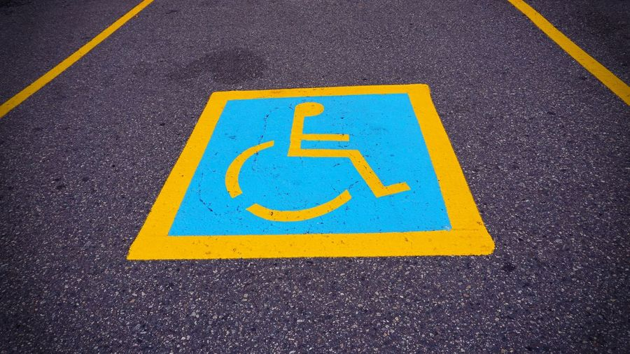 High angle view of wheelchair access sign on footpath