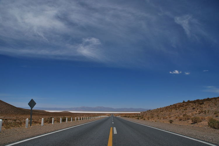Road towards salinas grandes, jujuy, argentina, against clear blue sky