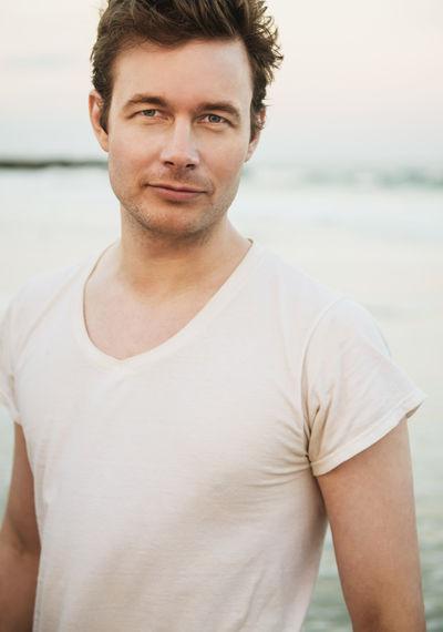 Portrait of man standing at beach