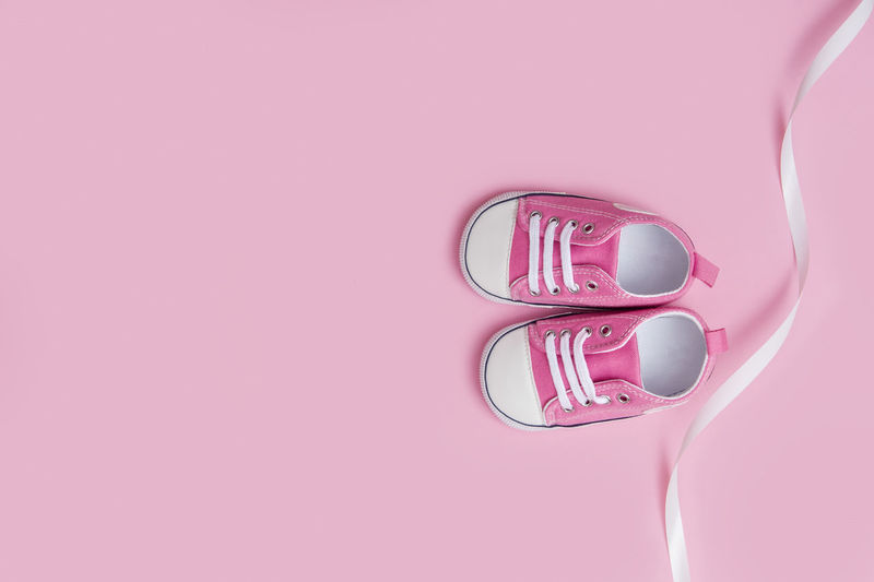 Pink Pair Booties Small Baby Shoe Kid Footwear Child Fashion Girl Newborn Birthday Sneaker Sport Trendy Pastel Beauty Nobody First Sentimental Calendar Flatlay Born Childhood Family Kids Floor Top View Essential Design Collection Object Little Sneakers Month Children New Life Rubber Trainer Boot Pregnant Pregnancy Birth Space For Text Christening Happiness Miniature Motherhood Pink Color Indoors  Copy Space No People Studio Shot Close-up Pink Background Colored Background Directly Above Still Life Single Object High Angle View Backgrounds Full Frame Cut Out Plastic Food And Drink Shape Kitchen Utensil