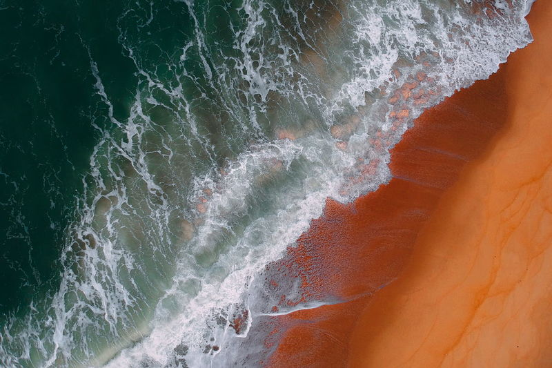aerial view of sea waves water texture background Water Beauty In Nature Sea Motion No People Power In Nature Power Wave Aquatic Sport Nature Sport Land Rock Scenics - Nature Day Outdoors Solid Rock - Object