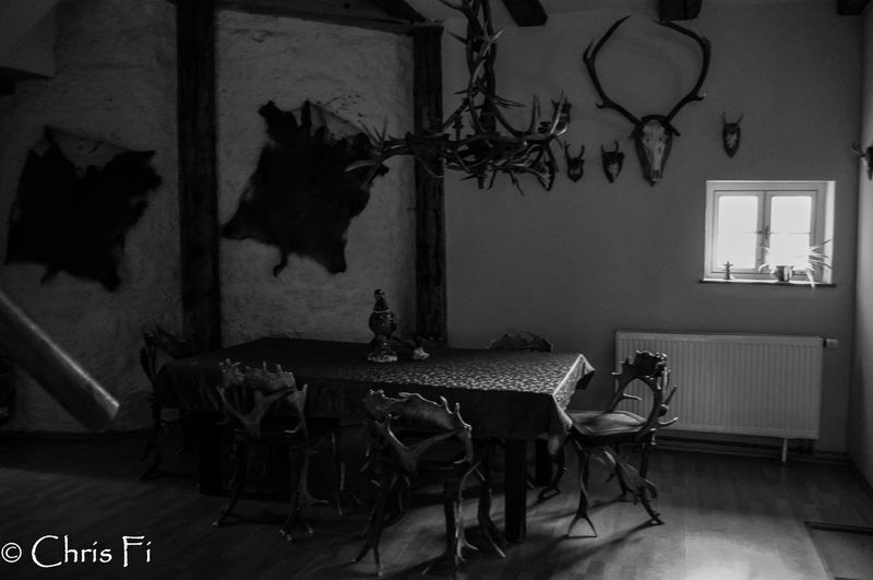 old Holidays Indoors  Table No People Chair Home Interior Lighting Equipment Wall - Building Feature Animal Animal Representation Medieval Hunting Hunting Lodge Old Castle Harz Blackandwhite Eyem Gallery Architecture Frame German Castle