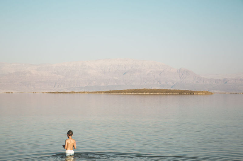 40 Degrees Celcius Dead Sea View Hot Hot Day Jordan Swimming Beauty In Nature Clear Sky Day Dead Sea  Lake Nature One Person Real People Rear View Salty Water Sea Shirtless Sky Summer Water Waterfront