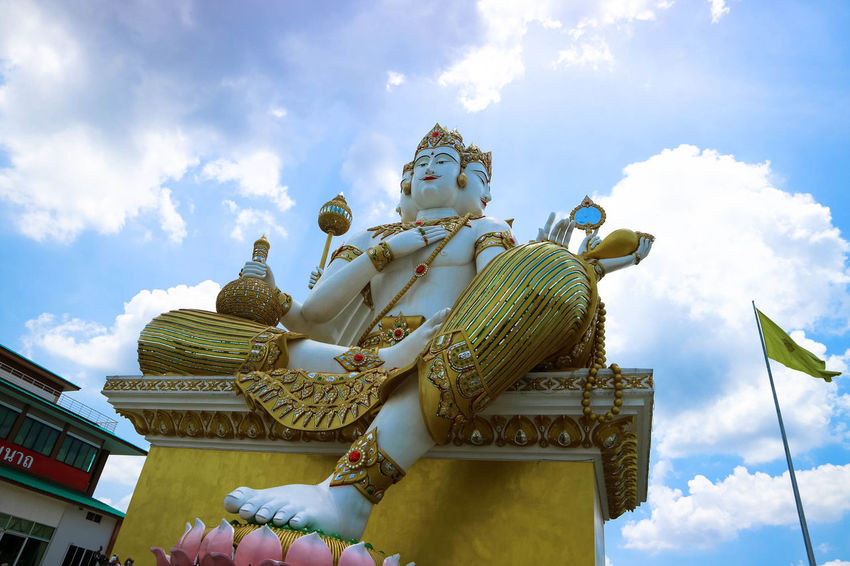 Architecture Building Exterior Built Structure Cloud - Sky Day Gold Colored Human Representation Low Angle View Nature No People Outdoors Place Of Worship Religion Sculpture Sky Spirituality Statue