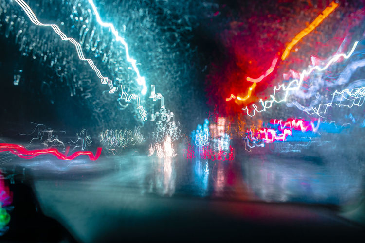Light trails on road seen through car windshield