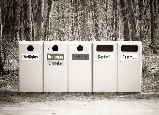 Recycle bins in nature Bin Bins Cans Communication Container Day EyeEm Best Shots Forest Garbage Garbage Bin Garbage Can German Glass Labels Nature No People Outdoors Park Recycle Recycle Bin Recycling Text Trash Trashcan Woods
