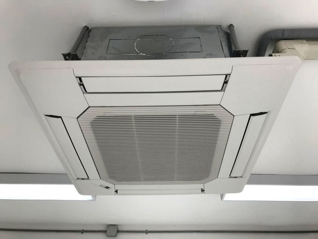 Ceiling type 4 directions air vent system hanging air conditioner unit in a modern office building Air Conditioner Atmosphere CleanRoom Modern Modern Workplace Culture Above Air Vent Air Ventilation Air Vents Ambient Ceiling Ceiling Type Electronics Industry Envoroments Grill Indoors  No People Office Building Office Interior Technology Temperature White Background White Color