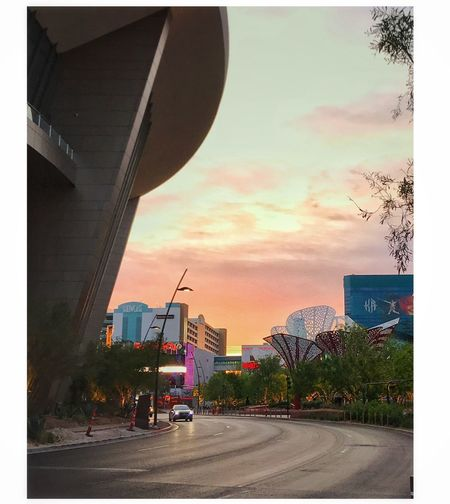Sunrise on Toshiba Plaza. Picturing Las Vegas Toshiba Plaza Architecture Road Built Structure Transportation Sky City Building Exterior Land Vehicle Street Outdoors No People Day Sunset Tree Modern Malephotographerofthemonth Eyeemphoto This Week On Eyeem IPhoneography