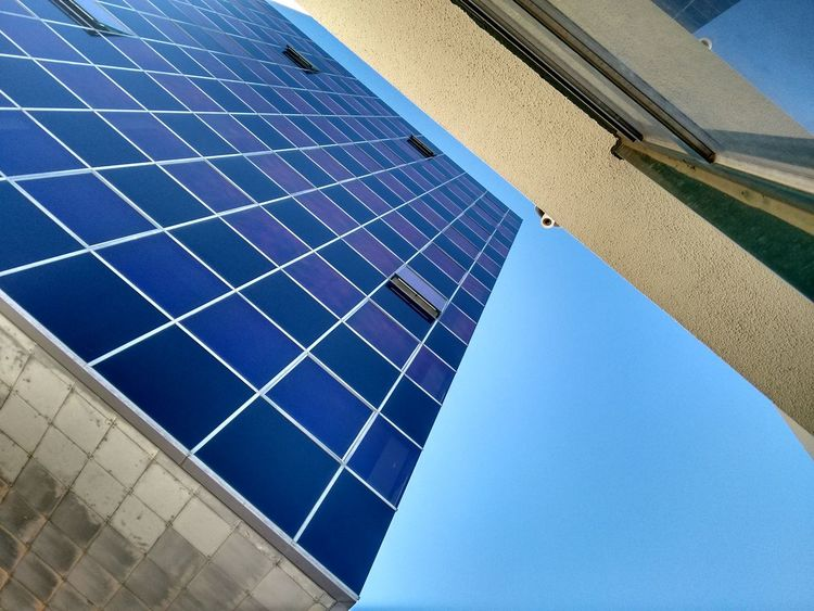 Architectural Feature Architecture Architecture Blue Blue Sky Building Built Structure City Day From Below Geometric Shape Low Angle View Modern No Filter No People Office Building Outdoors Repetition Sky So High Tall - High Vertigo Windows The OO Mission