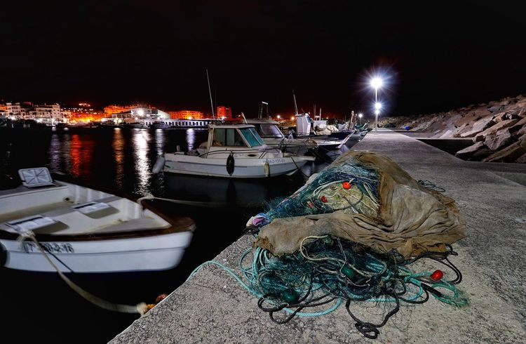 Moored fishing boats and fishing nets in Duquesa marina Duquesa Duquesa Marina Duquesa Spain Fishing Boats Fishing Boats And Fishing Nets Fishing Net Moored Boats Night Photography Nightphotography Boat Fishing Boat Fishing Net Fishing Nets Harbor Illuminated Mode Of Transport Moored Moored Boat Nautical Vessel Night Rope Sea Sky Transportation Water