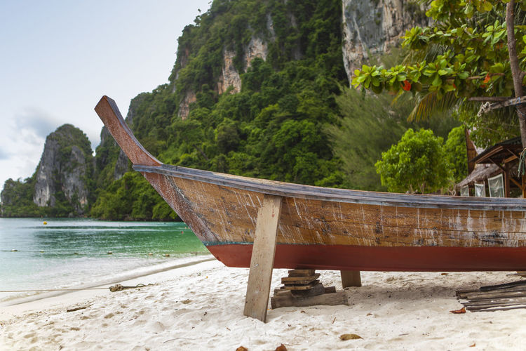 Phuket Thailand Beach Beauty In Nature Day Formation Land Long Tail Boat Mode Of Transportation Mountain Nature Nautical Vessel No People Non-urban Scene Outdoors Plant Sand Scenics - Nature Sea Sky Tranquil Scene Tranquility Transportation Tree Water