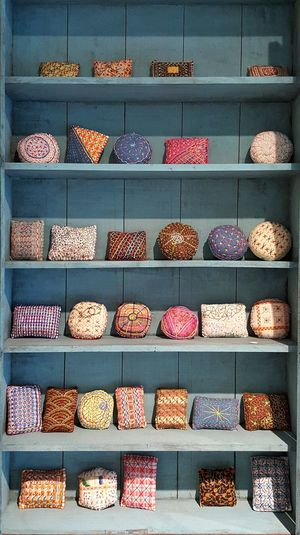 Various Cushions On Shelves