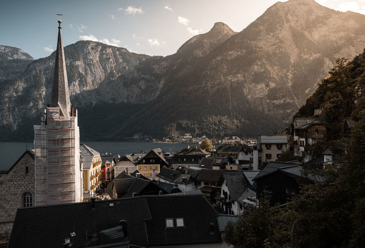 Townscape by mountains against sky