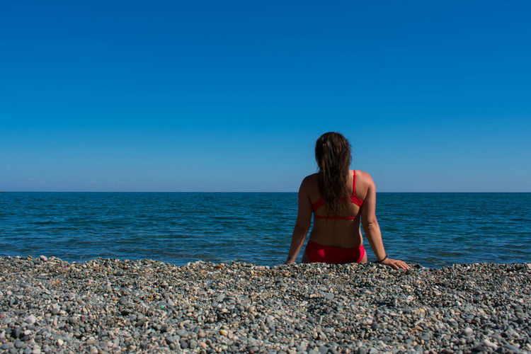 Sea Water Sky Horizon Over Water Blue Horizon Scenics - Nature One Person Lifestyles Real People Leisure Activity Beauty In Nature Rear View Beach Land Nature Clear Sky Women Young Women Hairstyle Outdoors