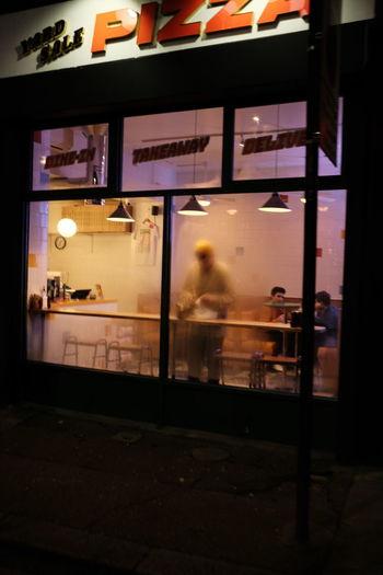 People in illuminated street at night