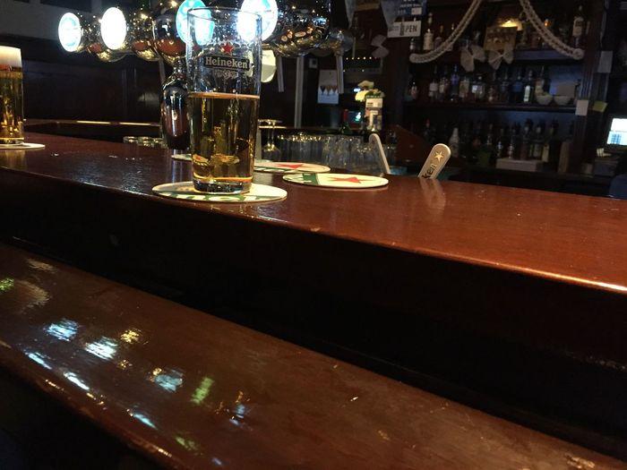 Laatste biertje van de avond / last beer of the night. Bar Counter Alcohol Drink Heineken