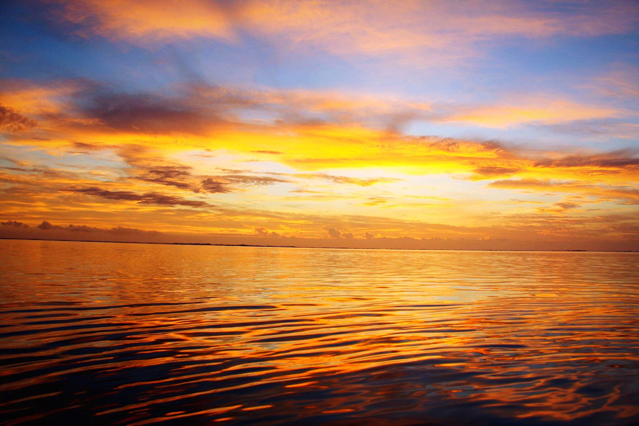 sunset, beauty in nature, orange color, nature, water, dramatic sky, sky, tranquility, scenics, tranquil scene, idyllic, sea, outdoors, no people