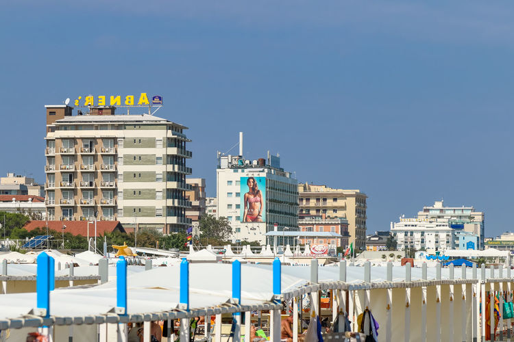 Hotels by the beach, Italy, Riccone Canopy Hotels Italy. Riccione Rimini Sunny Vacations Above Architecture Beach Blue Building City Cityscape Clear Sky Day Italy No People Outdoors Resort Riccione Sky Summer White