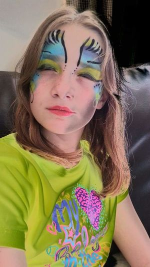 My forever child EyeEmNewHere Fun With Paint Negative Girl Makeup Fun Childhood One Person Leisure Activity Front View Casual Clothing Elementary Age Real People Close-up Lifestyles Girls Indoors  Young Adult Day People