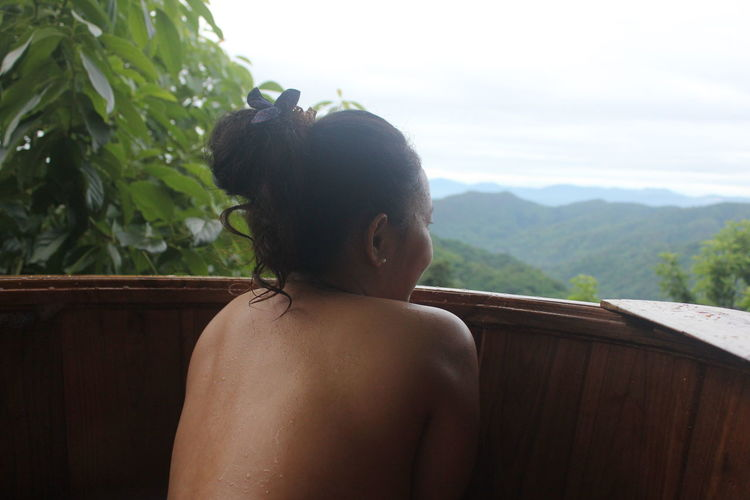 Rear view of naked woman looking at view