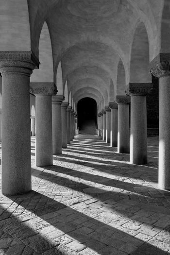 Architecture Architectural Column Arch Built Structure Arcade The Way Forward Building Direction History The Past Colonnade In A Row Corridor No People Indoors  Diminishing Perspective Repetition Empty Day Ceiling Ancient Civilization