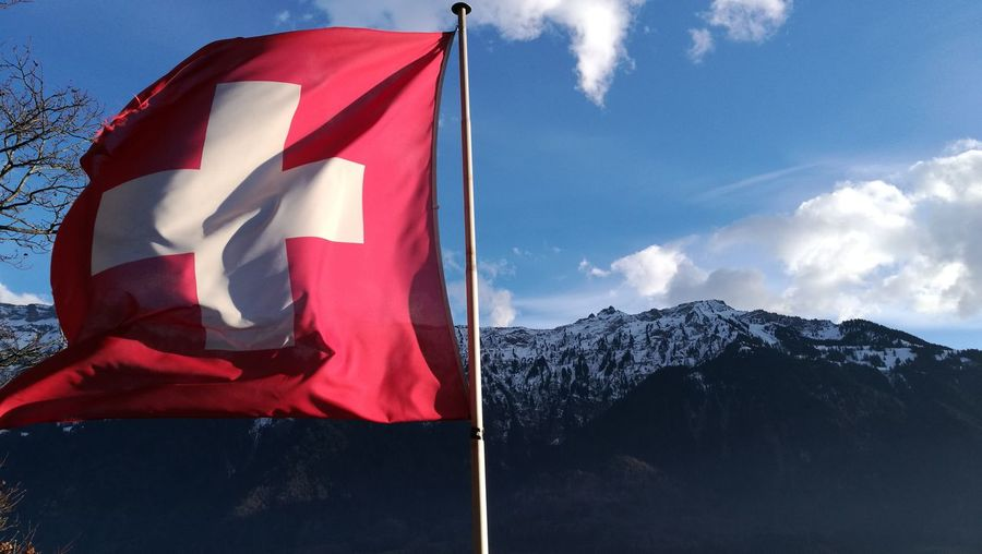 Switzerland EyeEm Selects Cloud - Sky Flag Sky Red Mountain Patriotism No People Outdoors