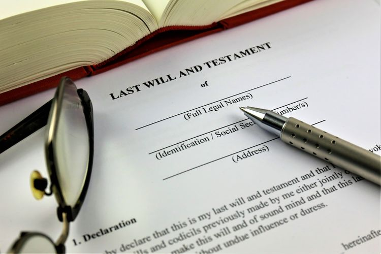 An concept Image of a last will and testament Business Testament Close-up Concept Day Document Indoors  Inheritance Last Law Legal Paper Paper Currency Pen Text Trust Will