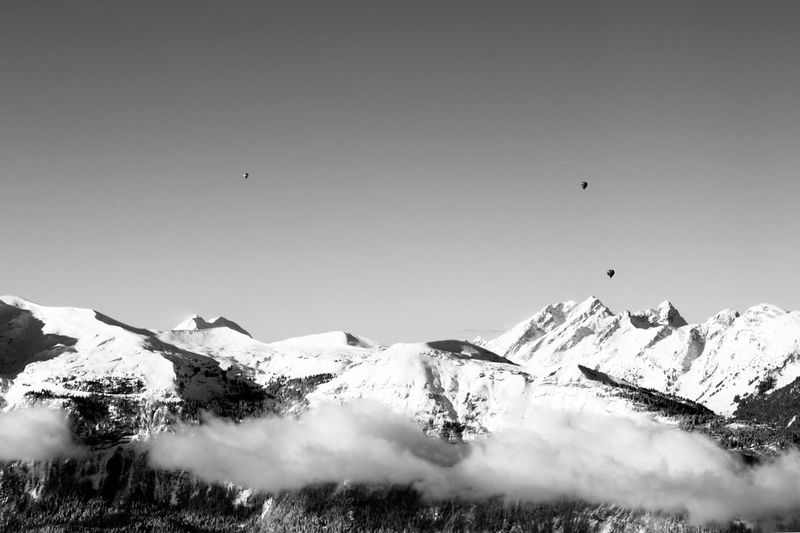 Balloons in the Alps Snow Winter Cold Temperature Mountain Scenics Nature Weather No People Clear Sky Tranquility Day Beauty In Nature Outdoors Snowcapped Mountain Tranquil Scene Mountain Range Landscape Flying Sky