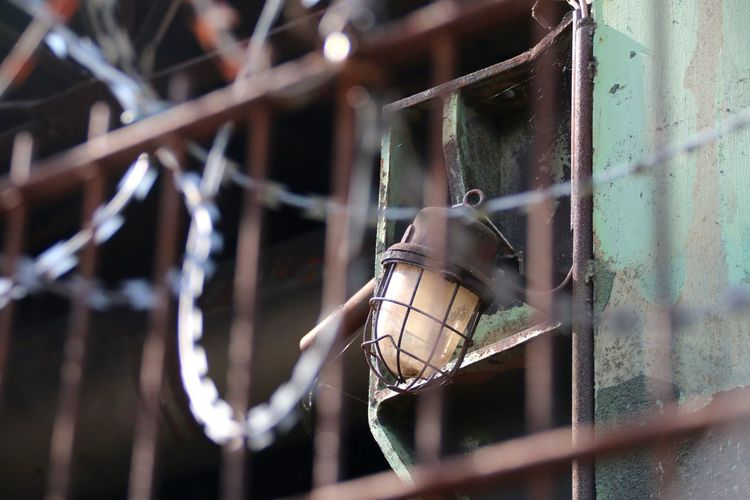 Close-up of lamp in cage