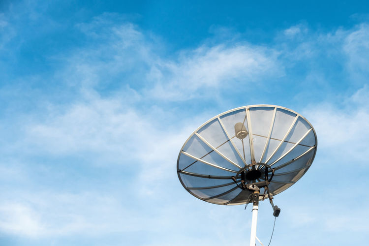 Low angle view of satellite dish against blue sky