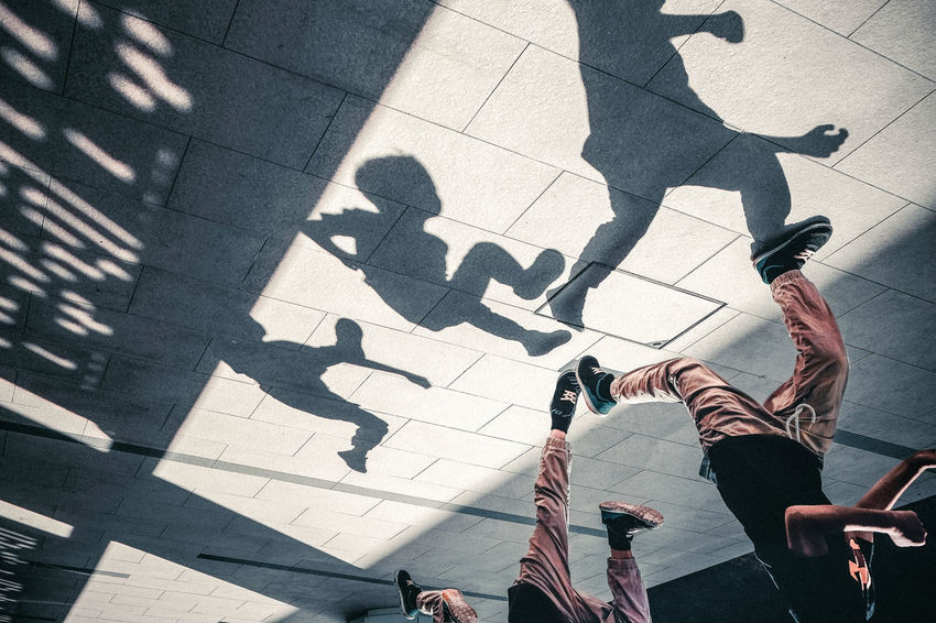 Light And Shadow Tiled Floor Focus On Shadow Paving Stone Running Sequence Sunlight Shadow High Angle View Street Low Section Boy Running City Lifestyles Outdoors Multiple Shots A New Perspective On Life