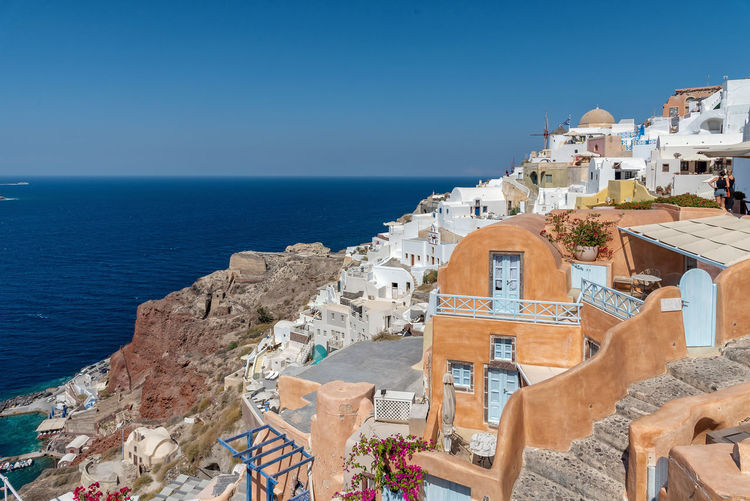 View of Oia - Santorini Cyclades Island - Aegean sea - Greece Greece Santorini Cyclades Mediterranean  Oia Village Island Architecture Volcano Caldera Water Building Exterior Built Structure Sea Building Nature Tourism Travel Horizon Over Water Travel Destinations History The Past Residential District Land Outdoors