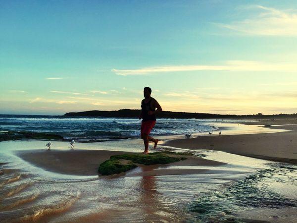 Enjoying sunset.. IPS2016Composition Beachphotography Peoplephotography Sunset IPhoneography Jogging Time