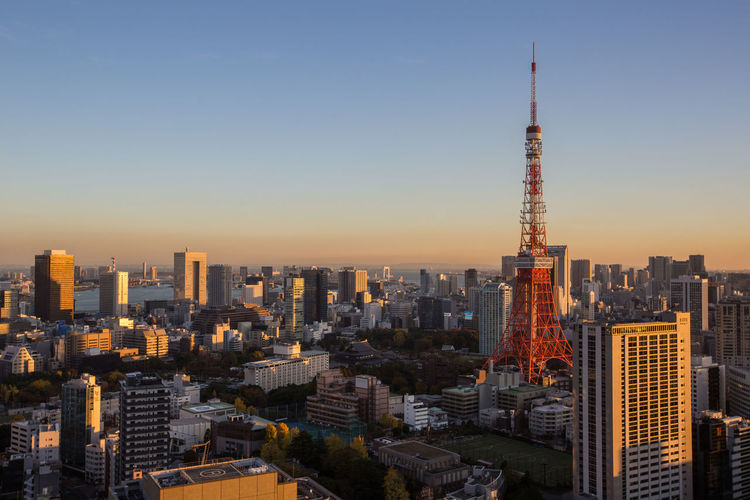 View of Tokyo Tower and surrounding Tokyo metropolitan areas at dusk. Architecture Battle Of The Cities Built Structure Cityscape Dusk Landmark Metropolitan Modern Red Skyscraper Tokyo Tower Tourist Attraction  Twilight Urban
