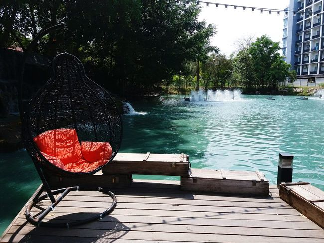Chill out Lake Water Day Outdoors No People Nature Seat Sitting Relaxing Chill Out Orange Color Water Fall Plant Growth Lake Side Green Lake Blue Lagoon Natural