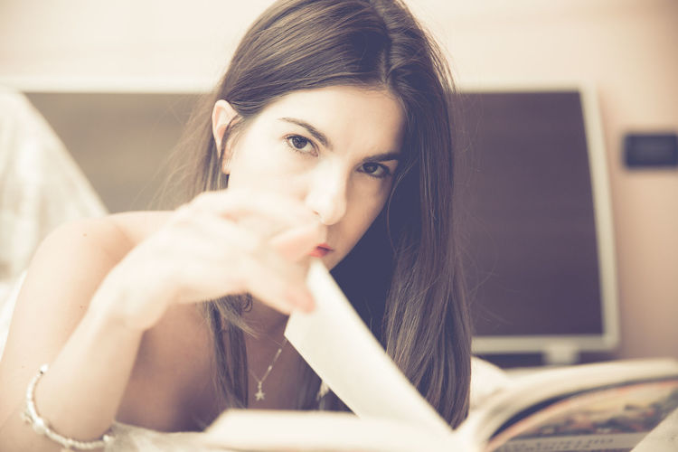 Book Casual Clothing Focus On Foreground Indoors  Looking Person Reading Relaxing Selective Focus Uncomfortable White Young Young Adult Young Women