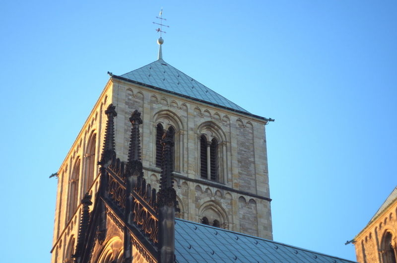 Churches in Münster, germany, during sunset Architecture Built Structure Building Exterior Religion Belief Place Of Worship Sky Low Angle View Spirituality Building Blue Clear Sky Nature Tower No People Cross Day Outdoors Spire  Clock Münster Cathedral NRW Münsterland