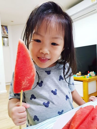 Smiling Girl Holding Watermelon Slice At Home