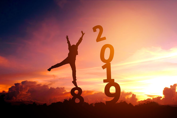 2019 Arms Raised Beauty In Nature Cloud - Sky Dollar Sign Effort Full Length Happy New Year Happy New Year 2019 Land Leisure Activity Lifestyles Men Nature One Person Orange Color Outdoors Real People Side View Silhouette Sky Sport Standing Sunlight Sunset