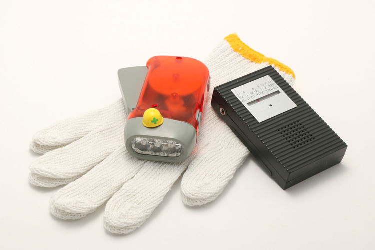 Emergency Light Radio Work Copy Space Danger Dangerous Disaster Equipment Evacuation Flashlight Helmet Indoors  Miniature No People Object Prevention Protection Safety Still Life Studio Shot Tool Toy White Background Work Gloves