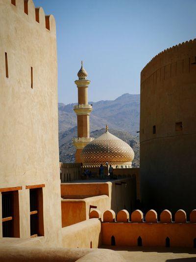 Oman Oman_photography Oman_photo Oman Fort Nizwa Fort Nizwa Mosque Islamic Architecture Minaret Light And Shadow Architecture
