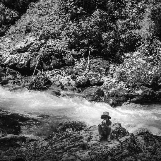 Vintgar Gorge, Slovenia Slovenia Adventure Beauty In Nature Black And White Black And White Photography Blackandwhite Bnw_captures Childhood Intriguing Leisure Activity Lifestyles Nature One Person Outdoors Real People River Rock - Object Tree Water Waterfall