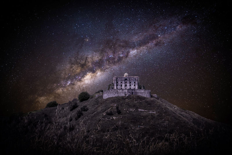 View Of Historical Building Against Starry Field At Night