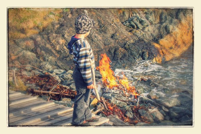 Casual Clothing Fire Fireplace Kid Nature Outdoors Rear View Sea Seaside Standing