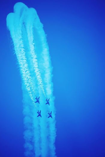 Aerial view of vapor trails in blue sky