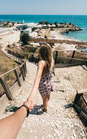 Travel Architecture Beach Built Structure Clear Sky Day Full Length Girl Horizon Over Water Human Hand One Person Outdoors People Real People Rear View Sea Sea And Sky Standing Summer Together Togetherness Vacations Water Women Young Adult