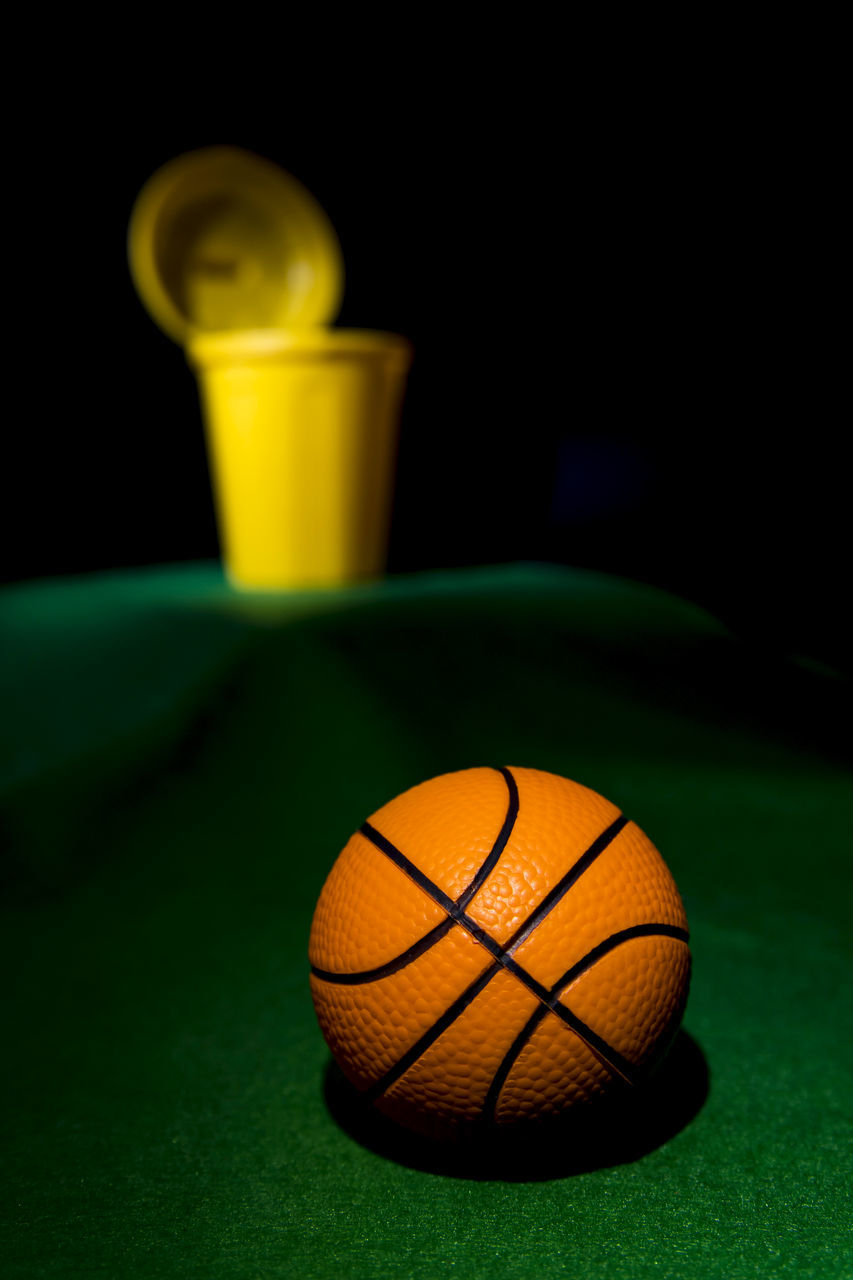 sport, still life, ball, indoors, no people, close-up, green color, night, black background, basketball - sport