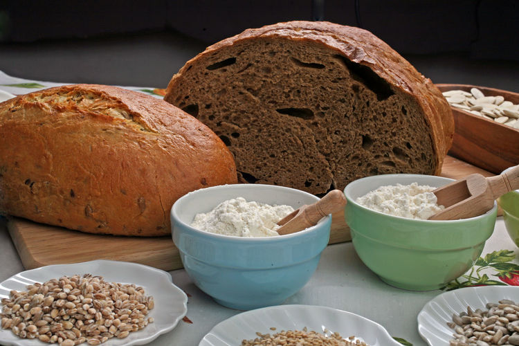 Bread With Flour And Wheat On Kitchen Table