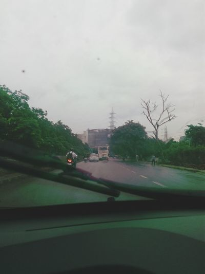 Viper  Car Glass Car Dashboard Outdoor On Road Tree Without Leaves Power Distribution Line Rainy Season Foggy Blurred Visions Greenary Trees Tower Pylone Building Structure FAR AWAY SSClicks SSClickPics Evening Light Mobile Camera Photography