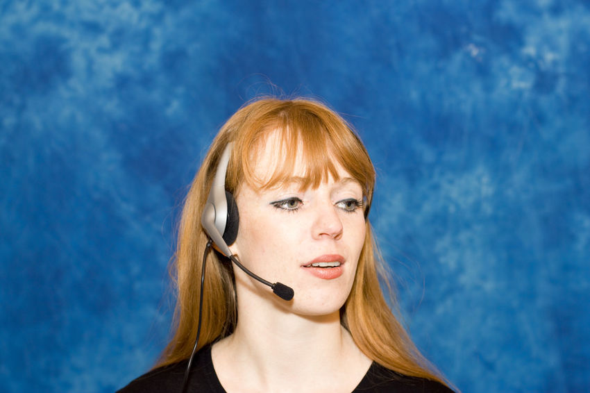 Young businesswoman using headset Beautiful Woman Business Businesswoman Call Center Callcenter Close-up Communication Front View Head And Shoulders Headset Headshot Listening Occupation One Woman Only One Young Woman Only Phone PhonePhotography Portrait Real People Red Hair Talking Technology Wireless Technology Working Young Women